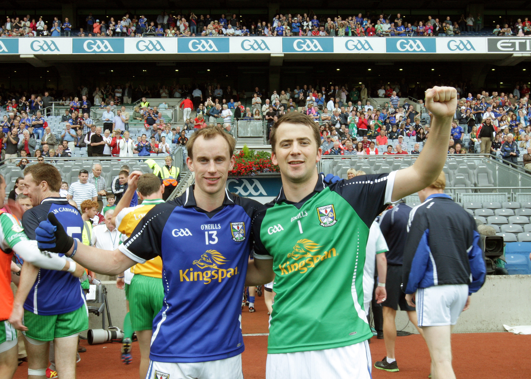 Martin Reilly and Alan O'Mara celebrate Cavan's historic win in Croke Park where both made a major contribution to the game. Photo: Adrian Donohoe.